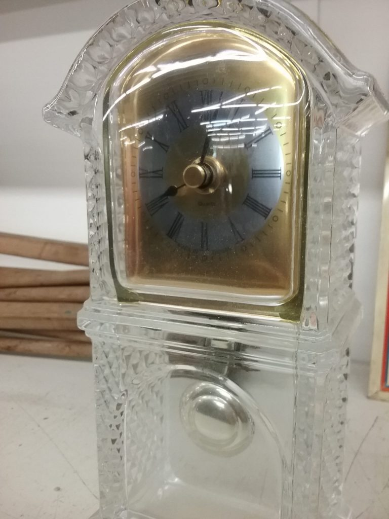 Transparent clock with shape of a house, 2018.