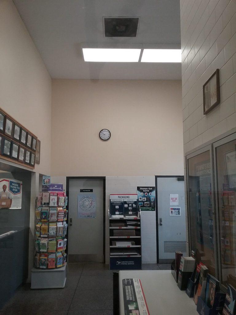 Wall clock in lobby of U.S. Post Office, Little Falls, MN, 2018.