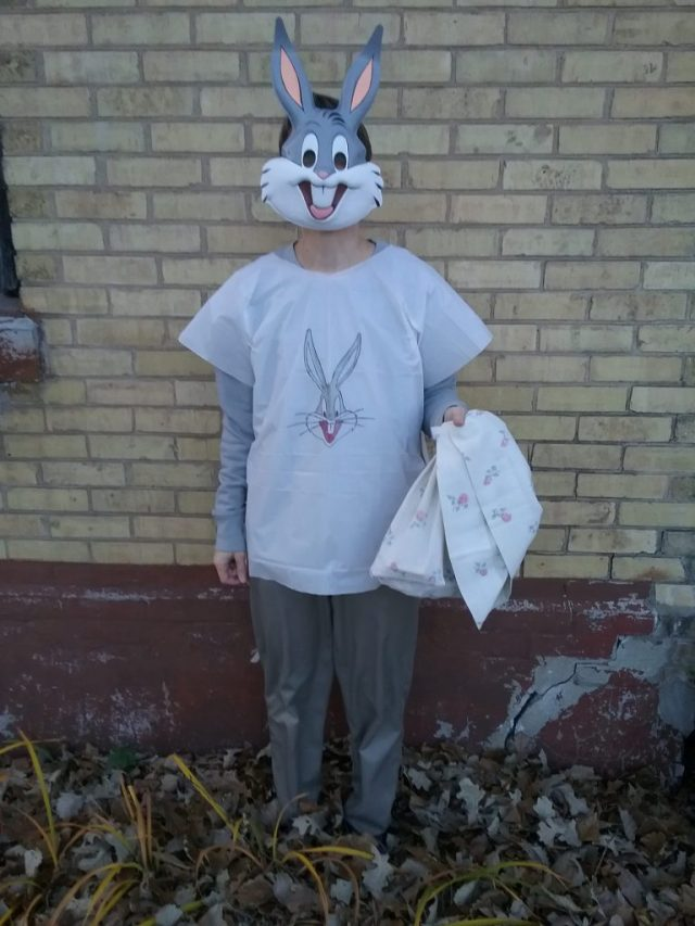 Me, pretending to be 8 in my Bugs Bunny Halloween costume, complete with pillow case candy bag, 2019. I'm probably blinking behind my mask, but you can't tell. Ha!