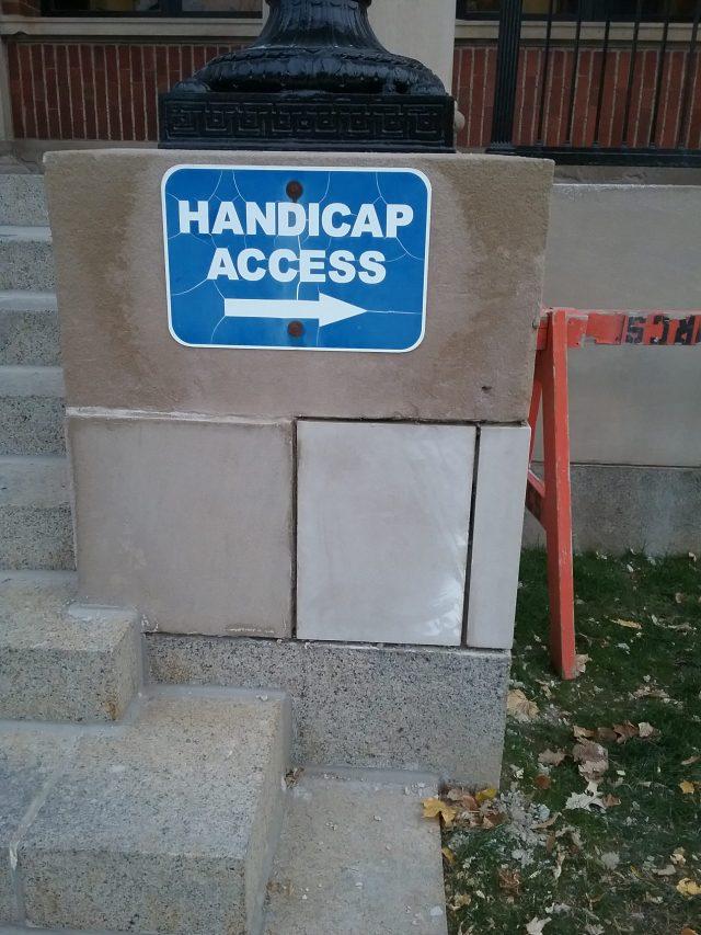 U.S. Post Office, Little Falls, MN, October 30, 2019. Cement facing panels replaced under Handicap Access sign.