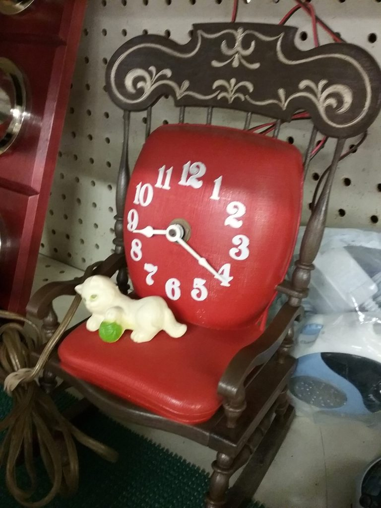 Red and black rocking chair clock with white kitty, 2018.