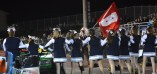 Bald Eagle cheerleaders link arms to stop the Bellefonte mascot, the Red Raider from running around the track in a victory lap after one of Bellefonte's touchdowns on November 6, 2015. Bellefonte beat Bald Eagle in their annual showdown, the Curtain Bowl 43-7.