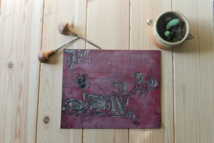 Red ink wash on linoleum carving