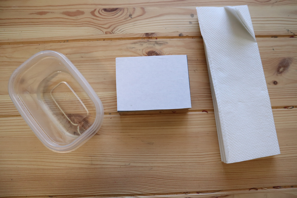 Use moistened paper towels to gently remove paper layer