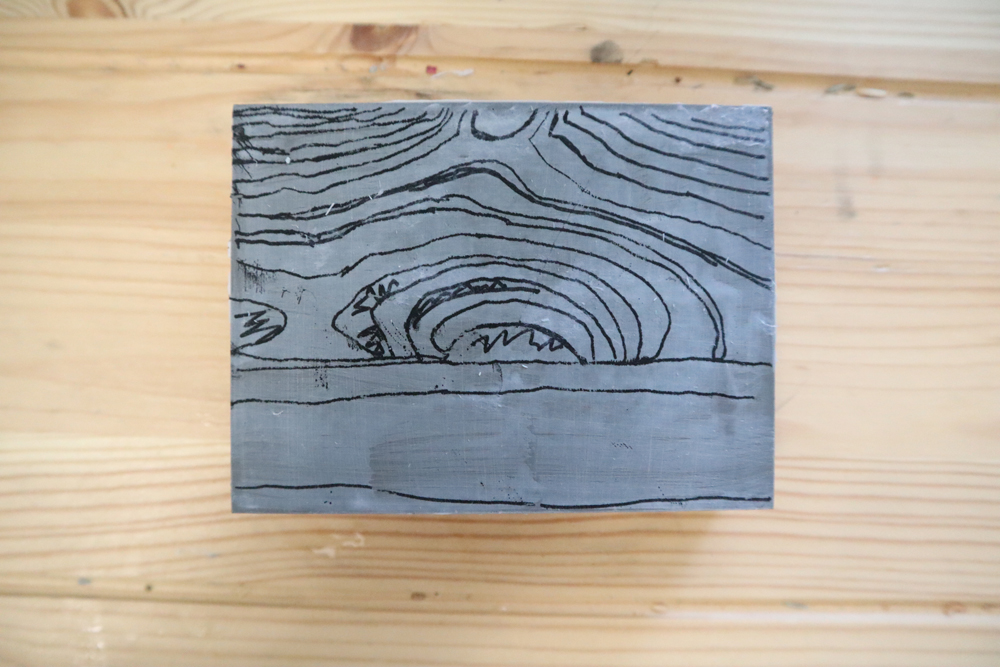 The reverse image sealed onto the linoleum
