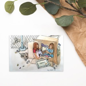 This is an image of two little girls sitting inside a large box, they are playing a board game monopoly and are near a fence with their two bloodhound dogs nearby.