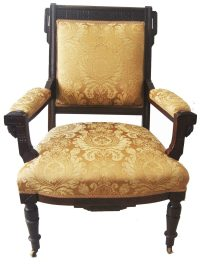 American carved wood and upholstered armchair