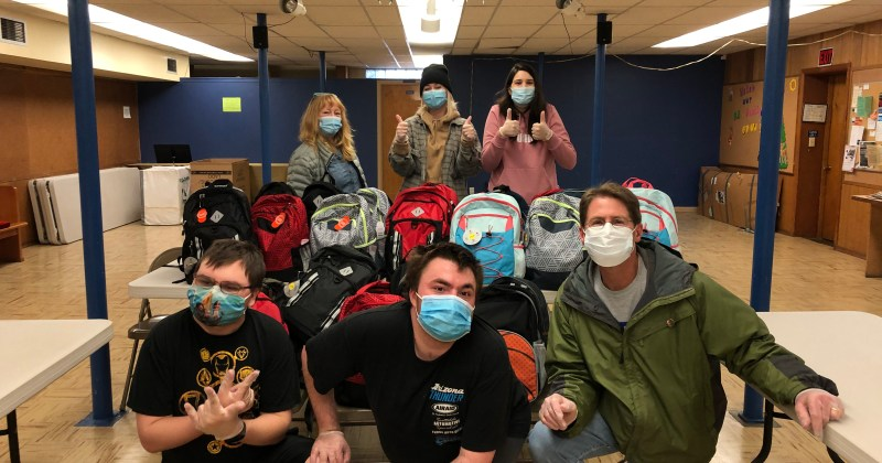 Marysville Aktion Club members fill school backpacks