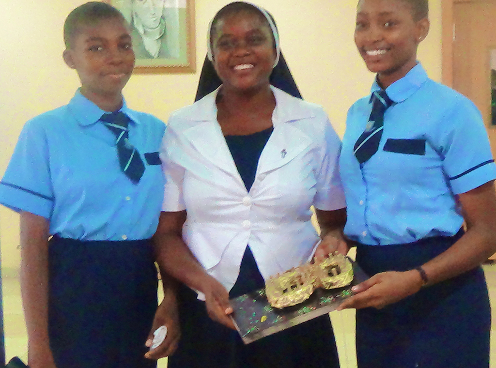 sr-gertrude-receiving-a-special-award-from-head-girl-izuagbe-valerie-onoteoghena-right-and-ozobia-chineze-left_17408155438_o