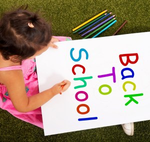 Girl Writing Back To School As A Symbol For Education