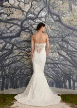 Nicole Miller Bridal lace covered low back wedding dress