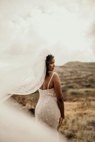 Hand beaded mermaid champagne wedding gown