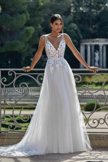 Fitted deep v bodice with lace apllique with flowing tulle skirt wedding dress by Sincerity Bridal