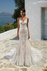 All over fit and flare lace gown with low illusion back by Justin Alexander