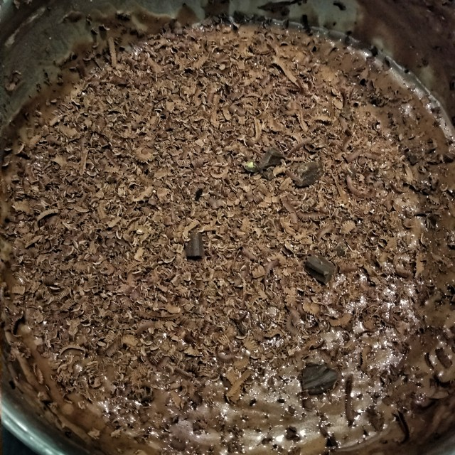 Grated_chocolate_to_the_brownie_mix