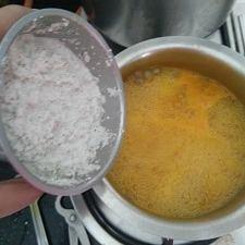 Adding the coconut gravy
