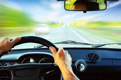 bigstock-Hands-on-steering-wheel-of-a-c-14021531(1)
