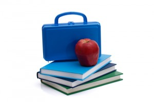 A blue lunchbox with an apple and books isolated on white, Healthy School Lunch