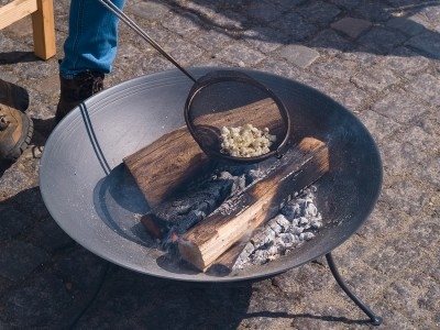 bigstock-Fire-Pit-With-Burning-Logs-Mak-11559356