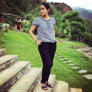 Tanvi shown wearing blouse and jeans