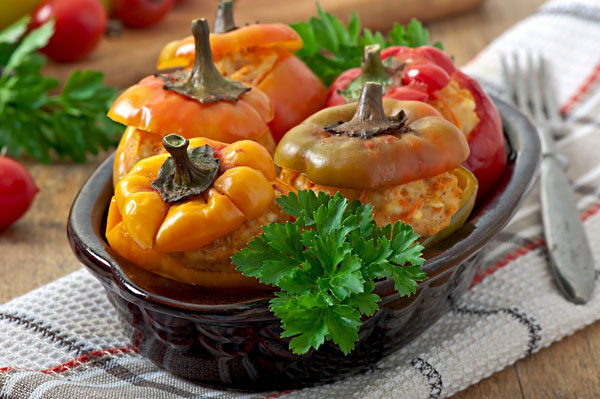 5 stuffed bell peppers with chicken served in a pot