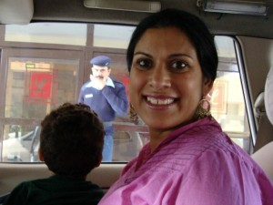Picture of Krip in car leaving orphanage after her visit