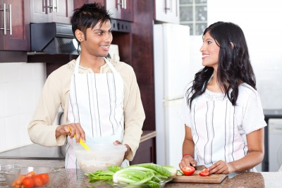 young indian couple cooking in modern kitchen