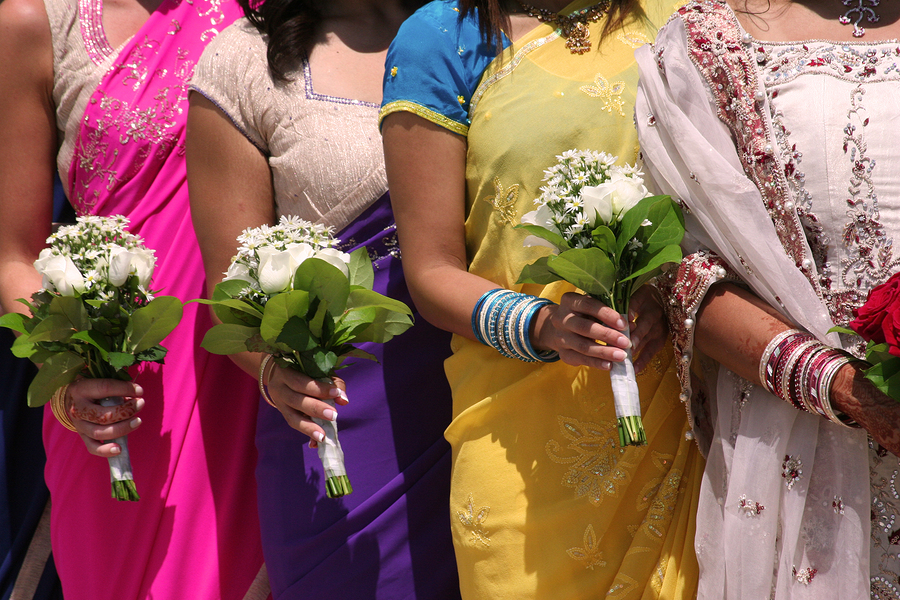 Bridal Party. Girls in colorful Saris at at indian wedding