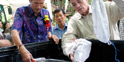 On the right Ambassador Blake and the mayor of Manado looking at the reptiles in the bags and bottles noting the horrible conditions under which these animals are smuggled and how many die in the process.