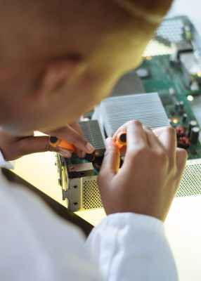 faceless professional repairer fixing video card in service center