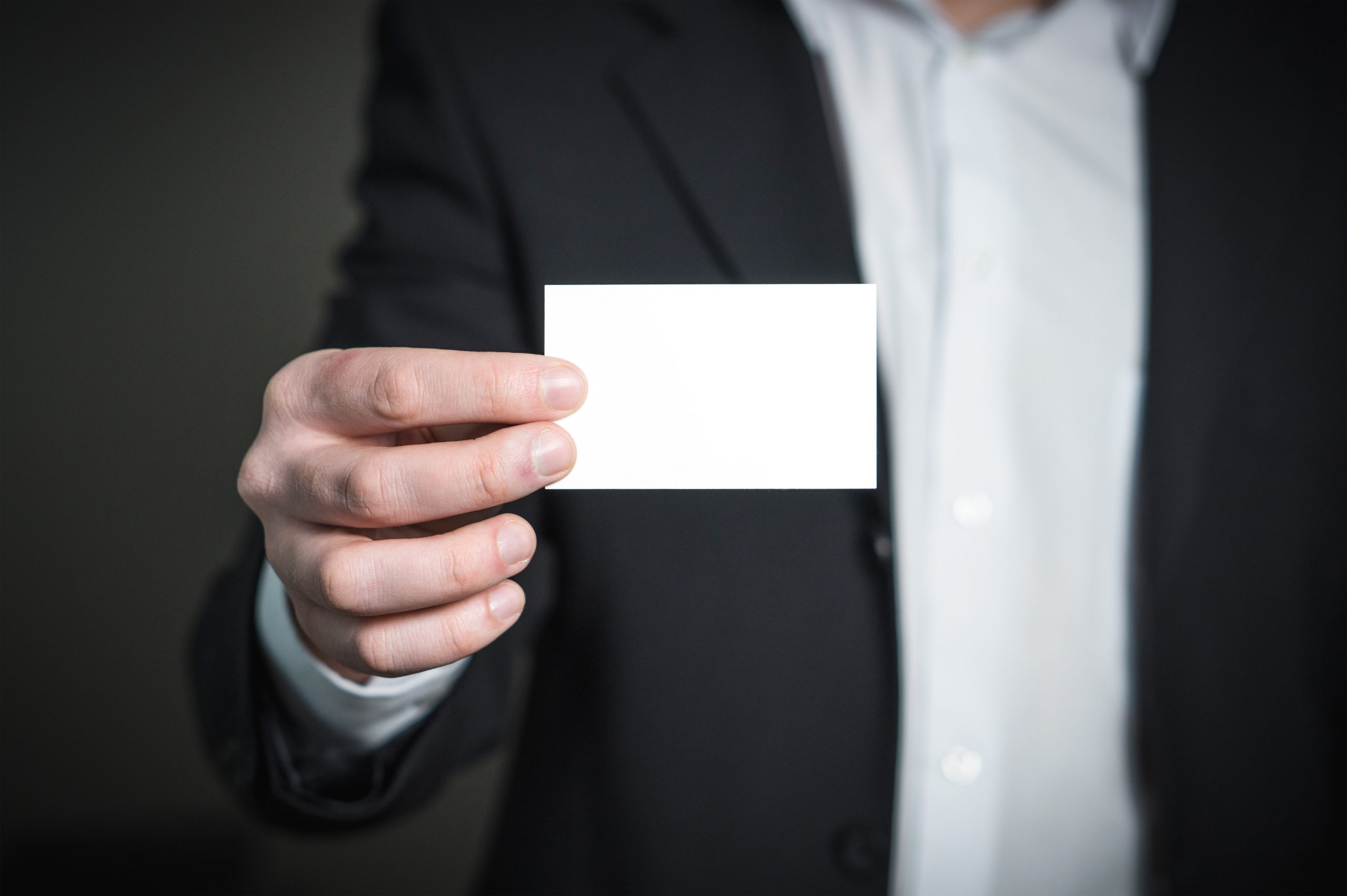 Person holding white paper