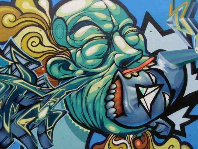 Gambar grafiti wajah hijau
