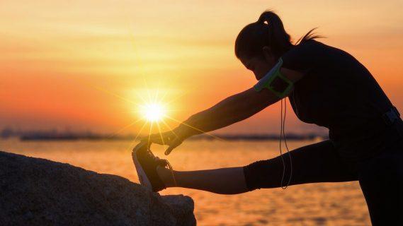 d9d5e74b aa74 4f13 9cf7 386c769fcb94 woman stretching sunrise outside run exercise