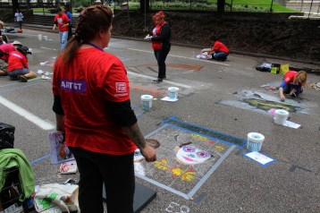 Despite overcast clouds and wet weather, artists were determined to capture the audience with the perfect creation