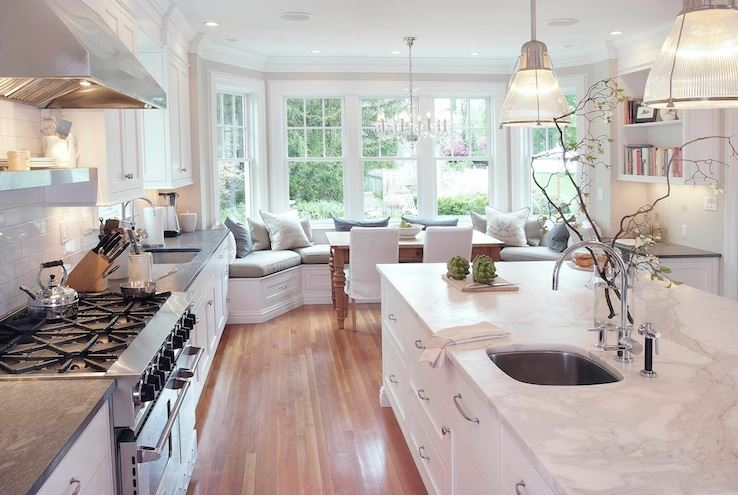 Coastal blog kitchen with soapstone countertop and banquette