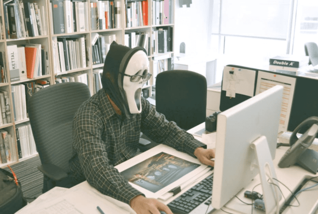 making money outside of training sessions - start a blog - man with mask at computer