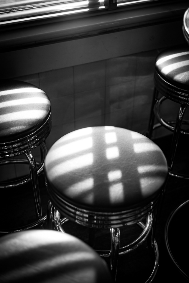 black and white patterns define the stools next to the windows