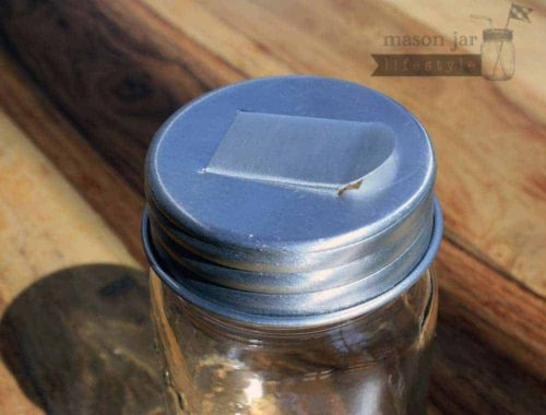 Aluminum grain dispenser lid for regular mouth Mason jars closed
