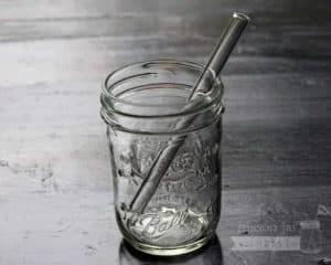 Thick glass smoothie straw in half pint Ball Mason jar