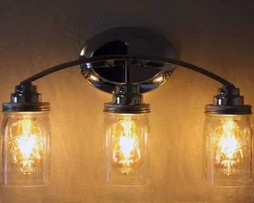 Light fixture with three quart open bottom Ball Mason jars, wide mouth lighting lids, and LED Edison bulbs