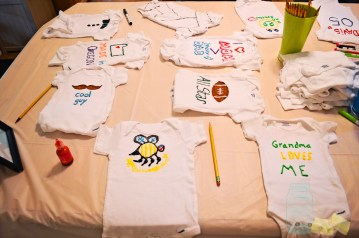 Decorated onesies for baby shower activity