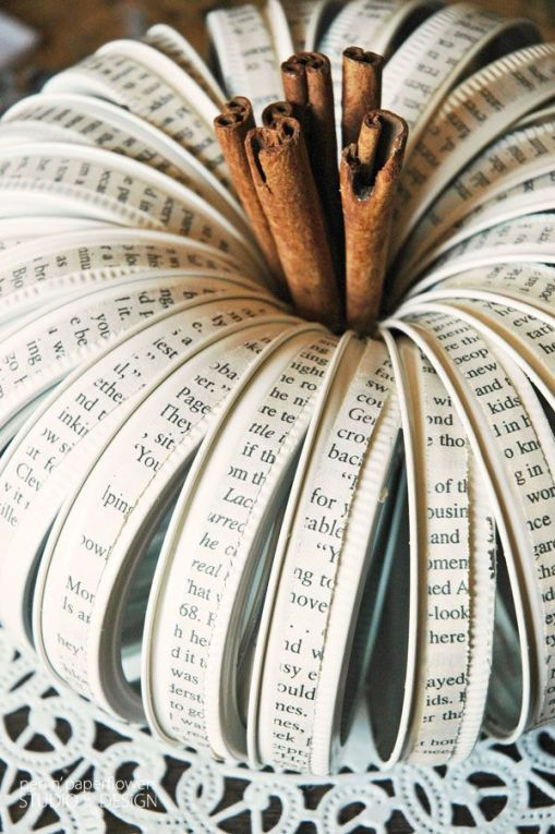 mason jar lids used to make classy pumpkin with book pages
