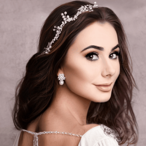 Beautifully crafted Eve Silver hair vine features high-quality clear crystals and man-made pearls which are hand-wired onto a silver finished vine. Ivory ribbon can be removed to allow flexibility to wear various ways.