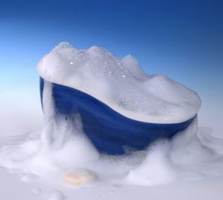 10964977 - symbolic cleaning and washing background with bathtub,soap and lots of foam in blue gradient back