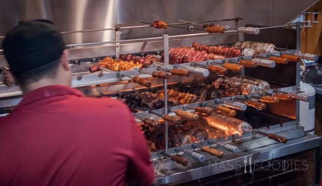 The meat skewers cooking at Terra Brasilis on Shrewsbury Street in Worcester, MA.