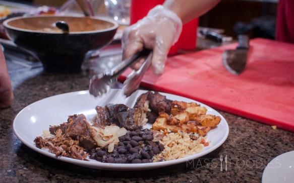 Carving meat from the skewer Terra Brasilis on Shrewsbury Street in Worcester, MA.