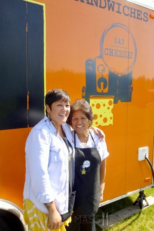 Teri Goulette, owner of Say Cheese!, posing with her mother outside of the food truck.