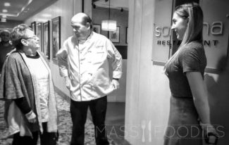 Veteran food writer, Barbara Houle praises Executive Chef Bill Brady. Sarah Connell, right. Outside of the interior entrance of Sonoma at the Beechwood Hotel in Worcester, MA.