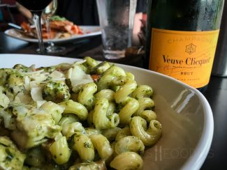 Chicken Pesto Pasta from 110 Grill in Worcester, MA (PAN-SEARED CHICKEN, ROASTED TOMATOES, ARTICHOKES AND CAVATAPPI PASTA, TOSSED IN A CREAMY PESTO SAUCE AND FINISHED WITH SHAVED REGGIANO.)
