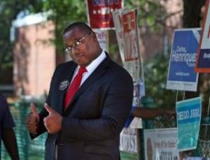(092617 Boston, MA) Mayoral candidate Tito Jackson gives the thumbs up as he greets voters outside Ward 12 on Tuesday, September 26, 2017. Staff Photo by Nancy Lane